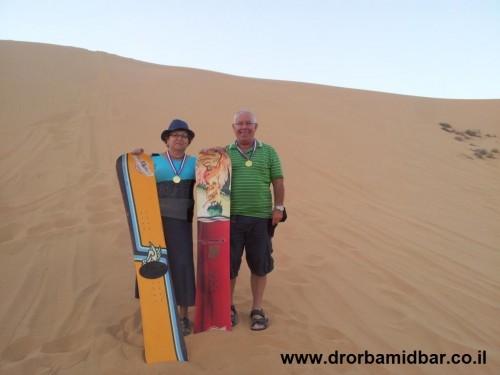 Sandboarding and smiling